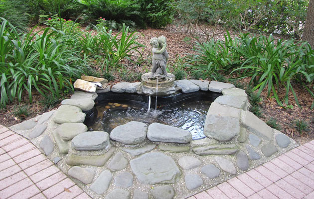 backyard fountain with stone embankment