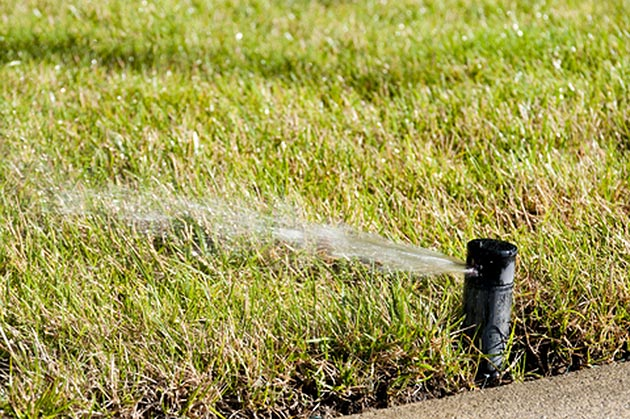 Maintaining a pop up lawn sprinkler system